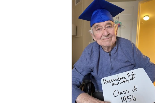 Man in graduation cap class of 1956