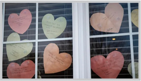 messages written on hearts on a window